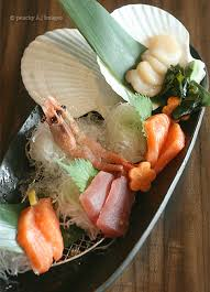 japanese kitchen opened first to arrive on our table is this plate of assorted sashimi  compos