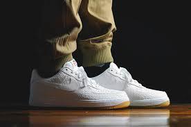 white croc nike air force 1 lows with a gum bottom air force crocodile white