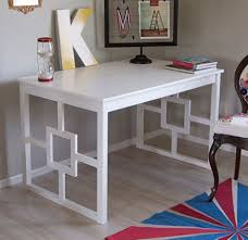 cheap decorating ideas embellish a plain ikea table with a few strips of wood put cheap office decorating ideas