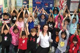 "Hawthorne second grade students practice ""Poga"" (Pilates + <b>Yoga</b>)"