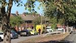 Wanted man FALLS from roof during police stand-off