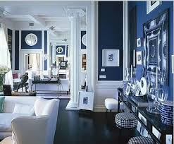 painting the walls blue and using white on the trim furniture creates a dramatic blue room white furniture