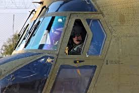 u s department of defense photo essay a pilot peers through the open window of a ch 47 chinook helicopter before landing