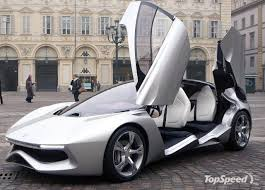 a fancy electric sports car with doors that flip up.