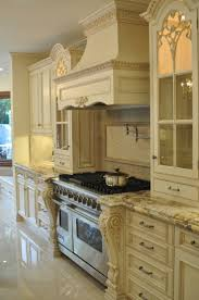 moulding kitchen traditional woven open french creamy white kitchen is traditional ornate with attention to de