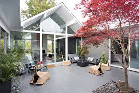 double gable eichler remodel 1950s courtyard patio photo in san francisco with tile blueprints office desk preview save