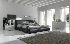 modern white bedroom design with white wall paint color and white nightstand and dresser and black bedroom furniture modern white design