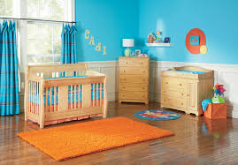 ultra bright colors comprise this bold nursery for boys sky blue walls paired with baby boy furniture nursery
