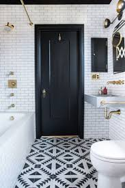 wall sconces bathroom lighting designs artworks: something retro in feel with white subway tile dark grout and brass plumbing fixtures then theres the very modern vanity light fixture