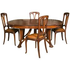 art nouveau mahogany table and 12 chairs decorated with berries by paul a dumas art deco dining room table