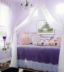 kitty otoole elegant whimsical bedroom: a whimsical mix of vintage fabrics couture styling and punchy purple create a sophisticated yet playful scene in this teen bedroom