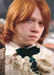 The five-year-old is named after glasses-wearing Pulp front man Jarvis Cocker, left, and fictional Harry Potter character Ron Weasley who is ginger, right - article-2579027-0355990F0000044D-96_306x423