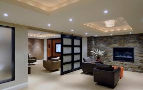 apartment large size lovely stone fireplace wall mantel also black leather sofa in apartment basement apartment lighting ideas