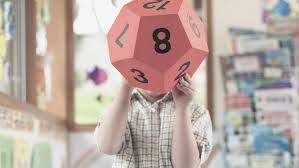 why is math so hard for my child help for math trouble dyscalculia child consulting a large hexagonal cube in math class