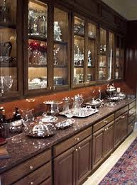 all phantom display lights are custom designed to fit your cabinets perfectly it does not matter if you have adjustable shelves or fixed shelves in your cabinet lighting custom fixtures
