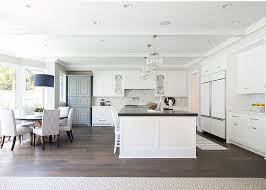 white kitchen with large nickel finish globe pendant chandelier by regina andrew above kitchen island beach house kitchen nickel oversized pendant