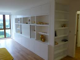 fitted bookcase with hidden television storage bespoke wall storage