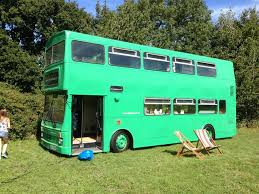 a 1982 metro bus converted into a three bedroom traveling home bedroom converted home