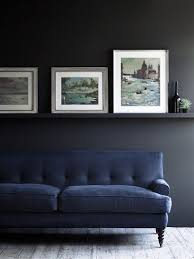moody blue and charcoal nice low picture rail too blending in with wall colour blue furniture