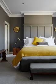 yellow and gray bedroom: in the main bedroom of product designer anthony joseph one half of kitchenware company joseph amp joseph mustard textiles were chosen to complement the