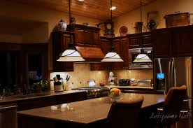 antique or not decorating above your cabinets above kitchen cabinet lighting