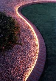 rope lighting in flower beds this could be pretty amazing looking and also area lighting flower bed