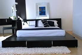 modern interior small bedroom furniture design ideas with white padded mattres and elegant black comfortable cushion bedroom furniture small