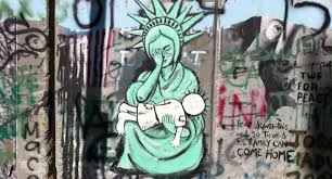 "statue of liberty americaniconstemple ""separation wall"" in the west bank that is covered in graffiti and this image can be found in bethlehem it is a picture of the statue of liberty"