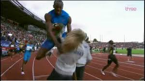 Usain Bolt crashes into <b>flower girl</b>