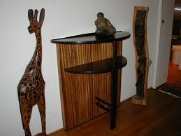 playful design to display some small sculptures the african sculptures on either side inspired the choice of the african hardwoods african inspired furniture