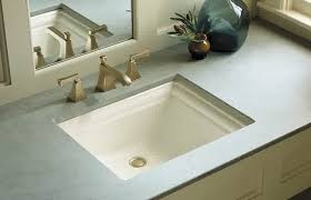 ideas bathroom sinks designer kohler: brushed nickel kohler bathroom faucets above rectangle bathroom sink under framed mirror