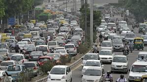 building more flyovers and subways will not solve s traffic heavy traffic moves along a busy road during a power cut at the traffic light