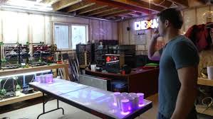Sask. <b>beer</b> pong legend unveils <b>2</b> new interactive <b>tables</b> | CBC News