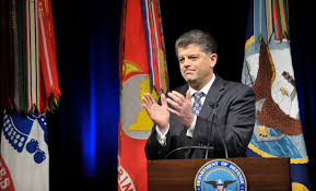 u s department of defense photo essay michael l rhodes the defense department s director of administration and management leads applause