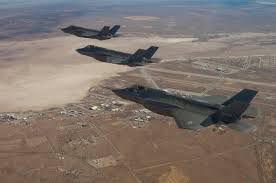 pentagon s big budget f fighter can t turn can t climb can t handout photo of three f 35 joint strike fighters flying over edwards air force base