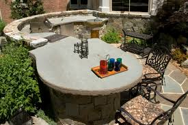 patio outdoor stone kitchen bar: outdoor kitchen with massive stone slab countertop