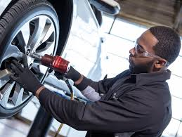 john elway chevrolet tire center chevy tire care certified service technician installing a chevrolet tire