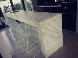 calacatta marble kitchen waterfall: calcutta marble kitchen benchtop waterfall possibly coming off the wall