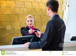 hotel receptionist check in man giving key card stock photo hotel receptionist check in man giving key card
