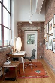small home office with iconic airia desk and the bubble lamp design adrienne derosa brick office furniture