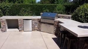 masonry outdoor kitchen sacramento california three rivers natural stone seating bar fire bowl feature