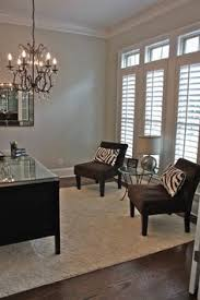 love the chandelier and zebra pillows for the office chandelier home office lighting
