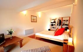 image of breathtaking sex bedroom mood lighting above cherry wood bedside table nearby organic cotton mattress bedroom mood lighting design