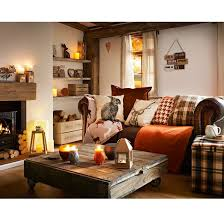 rustic style living room clever:  homely country cottage we love the extensive use of mismatched cushions in plaid strewn across the sofa mixed with the rustic woods of that earthy