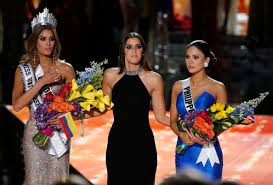 the list u magazine former miss universe paulina vega center reacts before taking away the flowers crown