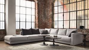 rustic living room wall with red brick and huge window idea feat elegant sectional sofa design brick living room furniture