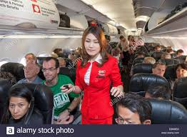 air asia flight attendants and passengers on flight from phnom air asia flight attendants and passengers on flight from phnom penh to bangkok thailand