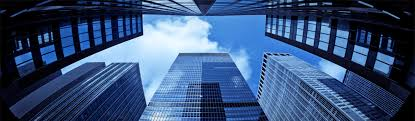 looking up blue sky tall commercial buildings web build home office header