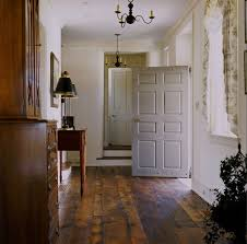 decorating with barn board entry farmhouse with rustic wood floor wood chandelier barn board