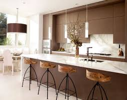 View In Gallery Exquisite Modern Kitchen White And Brown With Sleek Pendant Lights Above The Island  Decoist